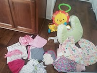 baby's assorted clothes and the original Boppy Ocean Springs, 39564