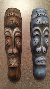 "Brown and blue wooden tiki masks. 7"" tall Mississauga, L5N 1Y2"
