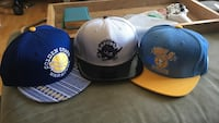 three assorted-color fitted caps