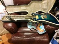 blue and white electric guitar Lincoln, 02865