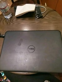 gray HP laptop with AC adapter