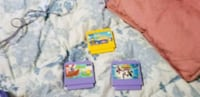three yellow and purple label game cartridges Wilmington