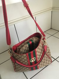 monogrammed brown and red Gucci leather shoulder bag