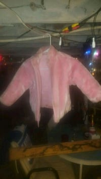 Pink and its reversable fur and leather Muncie