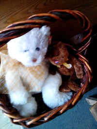 two white-and-brown bear plush toys; brown wicker basket Montreal, H8S 3P7