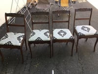 four black wooden framed white padded chairs Montréal, H4H 2G9