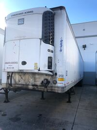 white and blue RV trailer 10 km