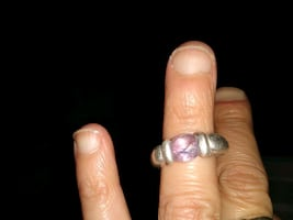 Stealing Silver ring with a purple stone