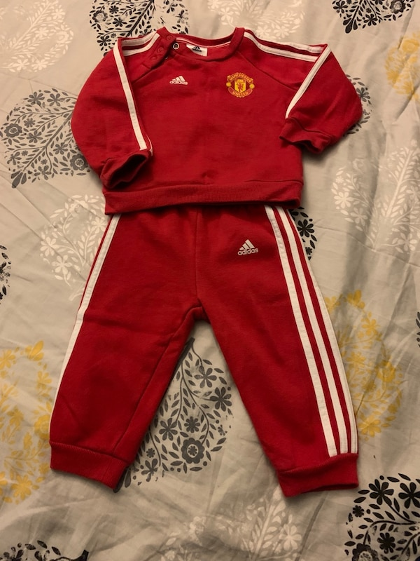 red and white Adidas track pants