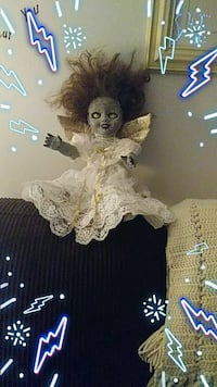 white and brown dressed porcelain doll 692 mi