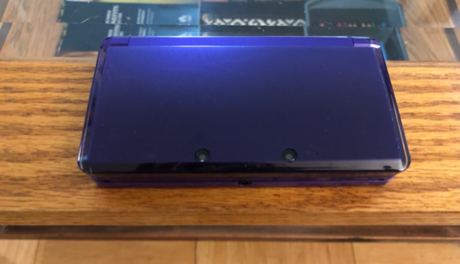 Nintendo 3DS (Purple), charger, and four games  4c612284-9960-43f4-9be4-9e5fa5921b1f