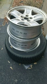 One tire 235/55r17 and three Crown Victoria rim's  Lancaster, 17603