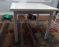 A wood wood table with 4 chairs Laval, H7W 3G9
