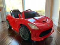 Red electric ride-on toy car. Made by Kids Trax toys 25 km