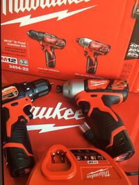 Milwaukee M12 tool combo kit : drill, Impacto , charge , 2 batteries M12, bag