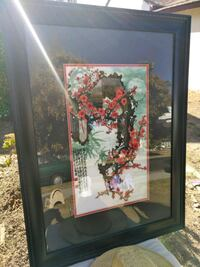 red flower painting with frame