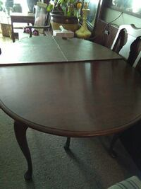 Oval brown wooden table
