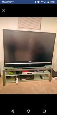 flat screen TV and white wooden TV stand 34 km