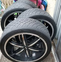 black and silver 5-spoke car wheel with tire set
