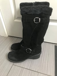 Pair of black suede ankle-buckle knee-high boots