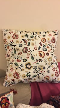white, red, and yellow floral throw pillow