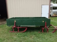 green and red utility trailer
