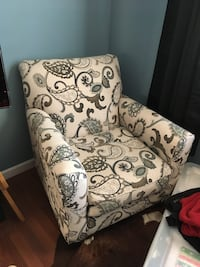 White and black floral sofa chair