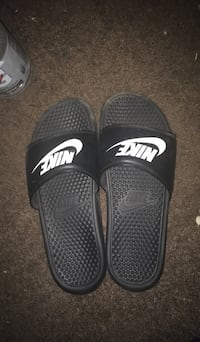 pair of black Nike slide sandals Detroit