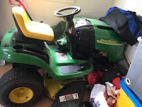 green and yellow John Deere ride on lawn mower Dayton, 21036