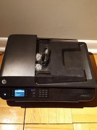 black HP desktop printer