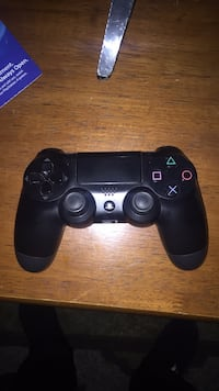 black Sony PS4 DualShock 4 2293 mi