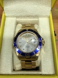 round blue Rolex analog watch with silver link bracelet