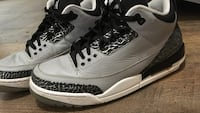 pair of white-and-gray Air Jordan 3 shoes