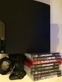 Sony PS3 slim console with controller and game case lot