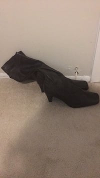 Pair of black leather boots never worn size 10 in the box moving must go  Fort Washington, 20744