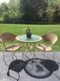 Wicker and metal table and 2 chairs