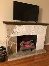 Working electric stone fireplace that heats up and lights up New Port Richey, 34654