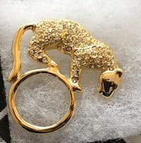 Gold color brooch with stones NEW in box Longueuil