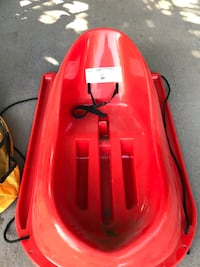 Red plastic sled with snow cover Ottawa, K1T