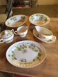 China 8 place setting of Pope Gosser Dogwood pattern includes tea cups,saucers, bread plates, dinner plates, small bowls, soup/salad bowls, 1 oval serving bowl, 3 round serving bowls, 1 meat platter , sugar, creamer , and gravy boat with saucer .  Produce Boonsboro, 21713