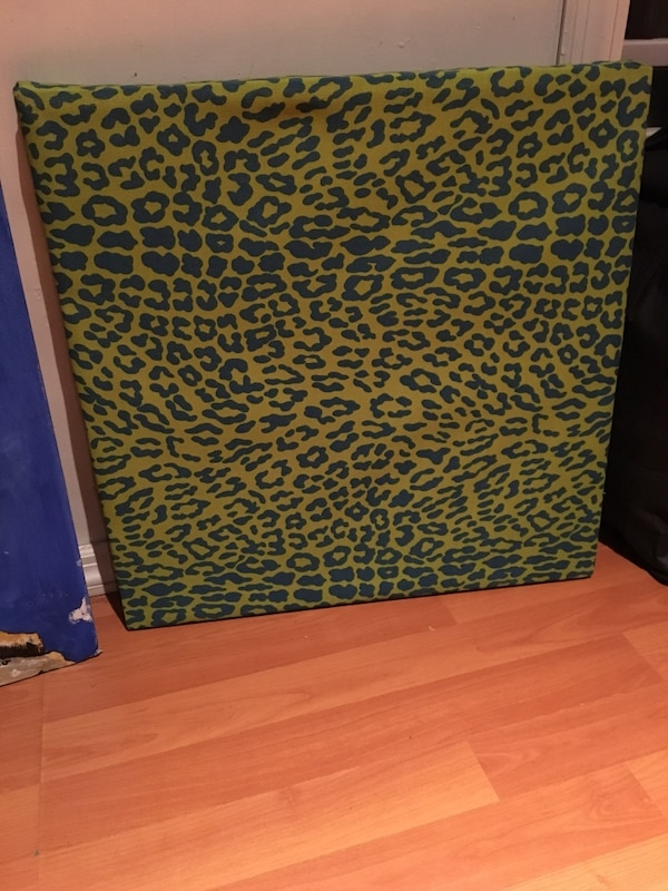 Brown and black leopard print area rug