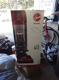 black and gray Hoover upright vacuum cleaner box null