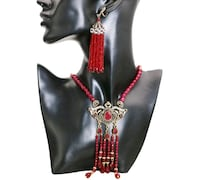 women's red and silver necklace Vancouver, V5Z 4H4