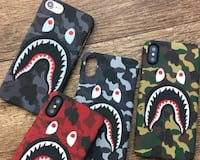 four assorted-color camouflage A Bathing Ape shark phone cases Toronto