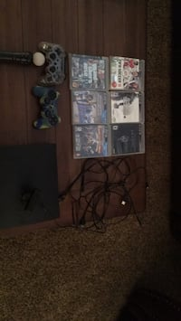 Black sony ps3 slim console with controllers and games and other stuff Edmonton, T6R 2Y3