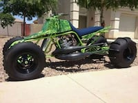 green and black dune buggy