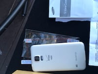 White samsung galaxy S5 phone with cover & wireless Charger