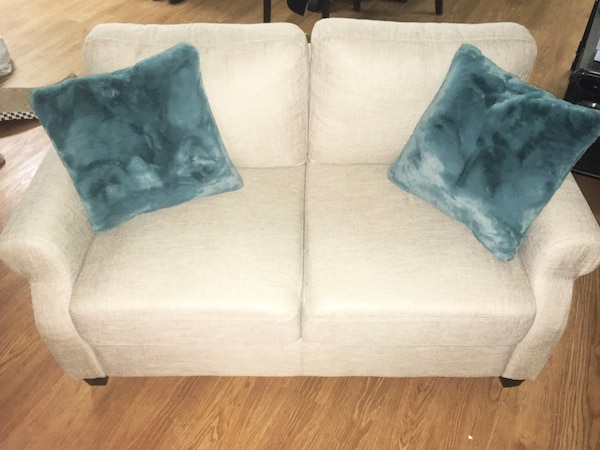 Beige love seat and living room couch