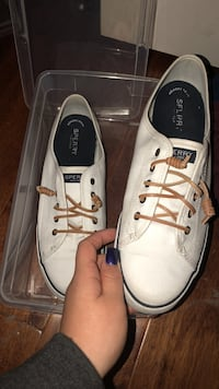 white-and-black Sperry lace up low top sneakers