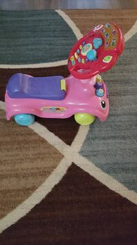 children's pink, blue, and red plastic ride-on toy Reston, 20190